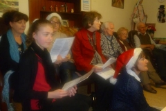 Young and old join in the singing
